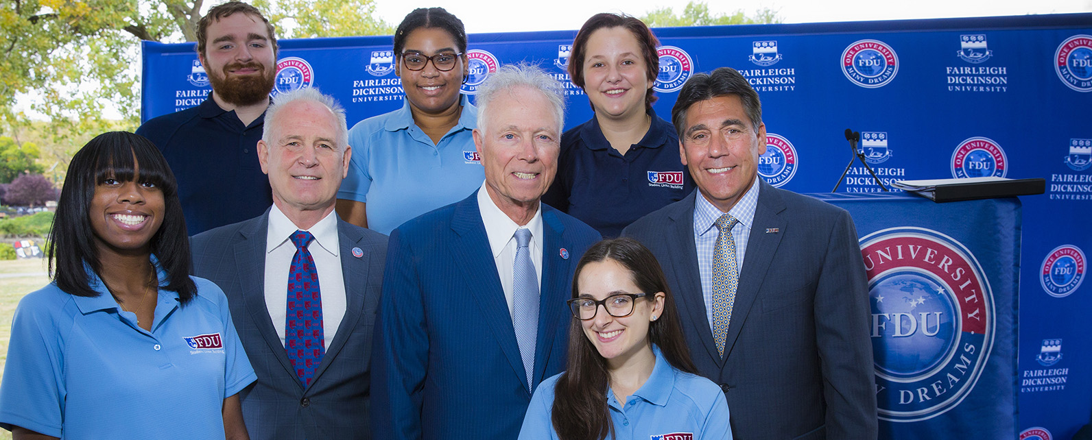 Senior Vice President for University Advancement Rick Reiss, Truste Greg Olsen and University President Christopher Capuano with students from FDU's Metropolitan Campus.